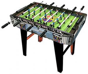 Photo of a foosball table made of black wood with a green table top.
